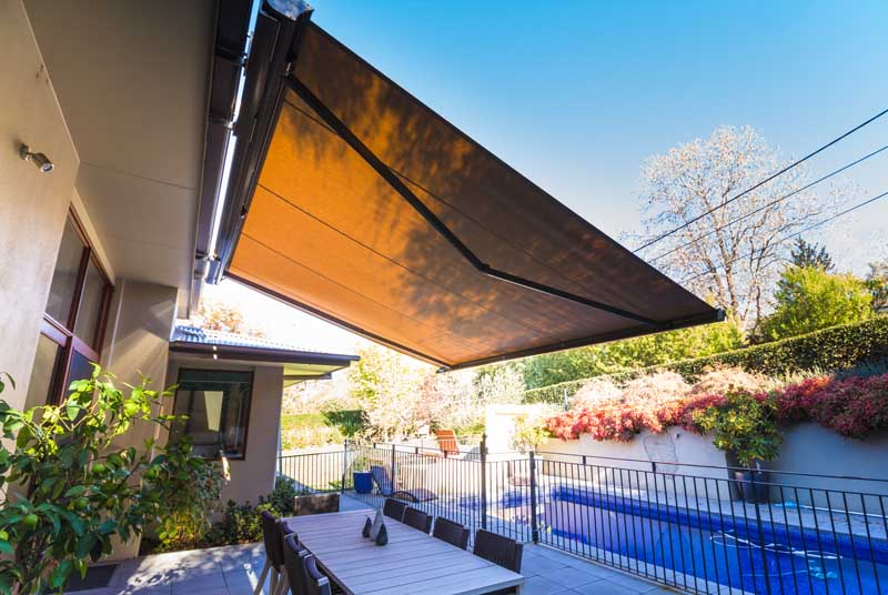 canberra folding arm awning